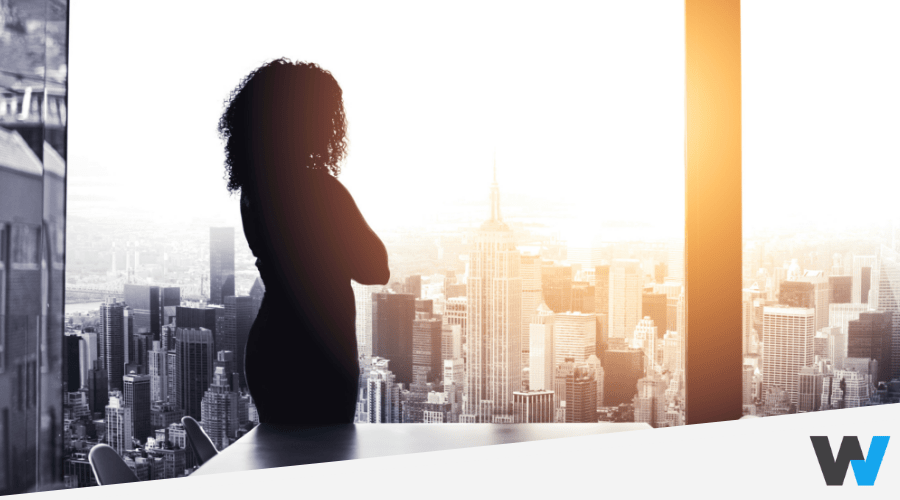 woman looking outside through a window, new york city background