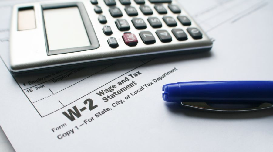 Tax Form W-2 With Calculator & Pen