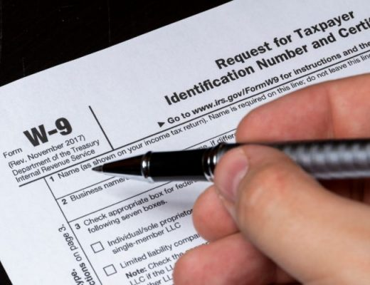 person filling out form w-9