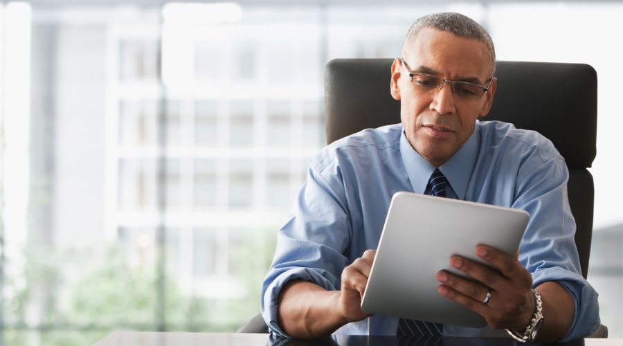 business owner reviewing which payroll schedule is best for his company