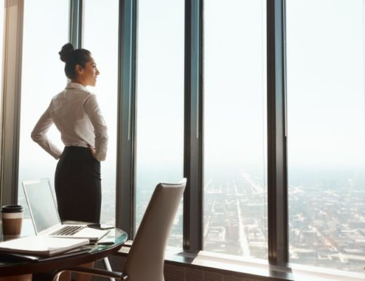 Professional woman looking out her office window