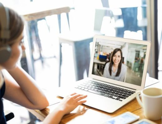 Remote employee video conferencing with her boss